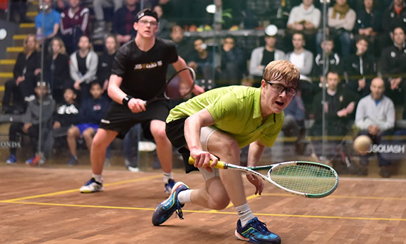 Two players playing competitive squash