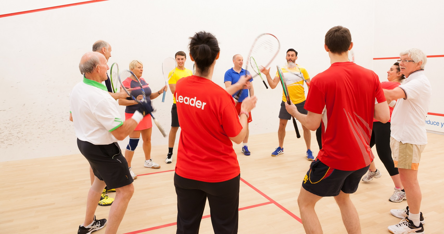 Group of squash players on court together