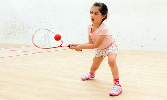 Young child playing squash