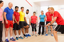 Coach tutoring an England Squash course
