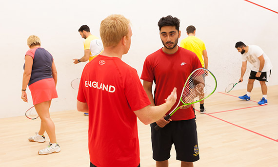 England coach tutoring at an England Squash course