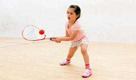 Young child  playing squash
