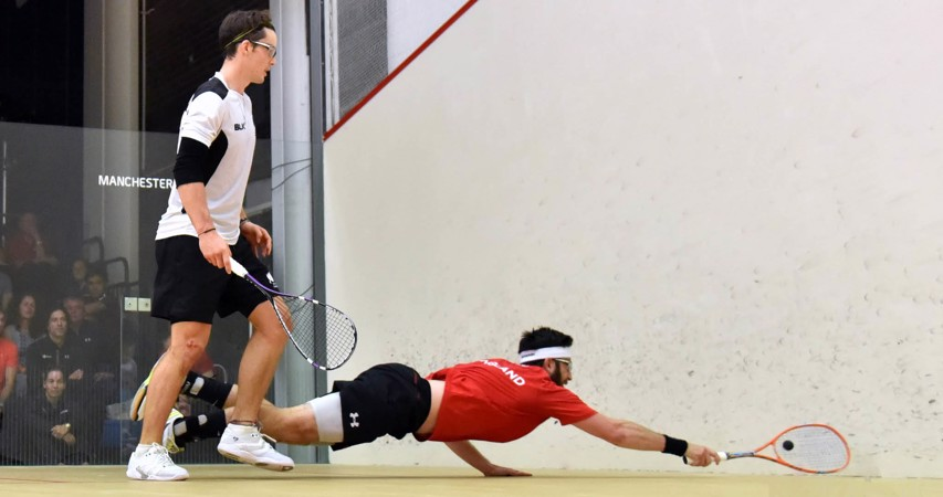 Paul Coll watches as Daryl Selby performs a Superman dive of his own