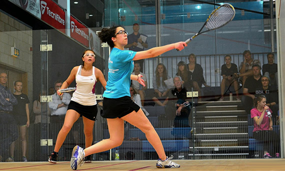 Two female players playing competitive squash