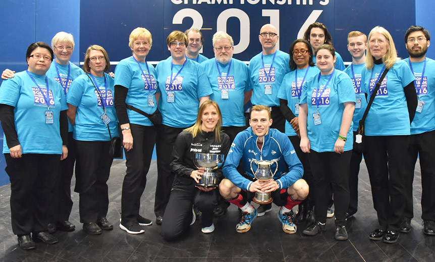 Volunteers standing with Nick Matthew and Laura Massaro at the National Squash Championships