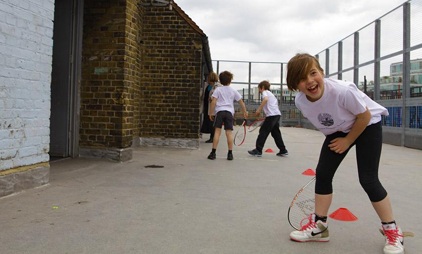 School kids playing squash