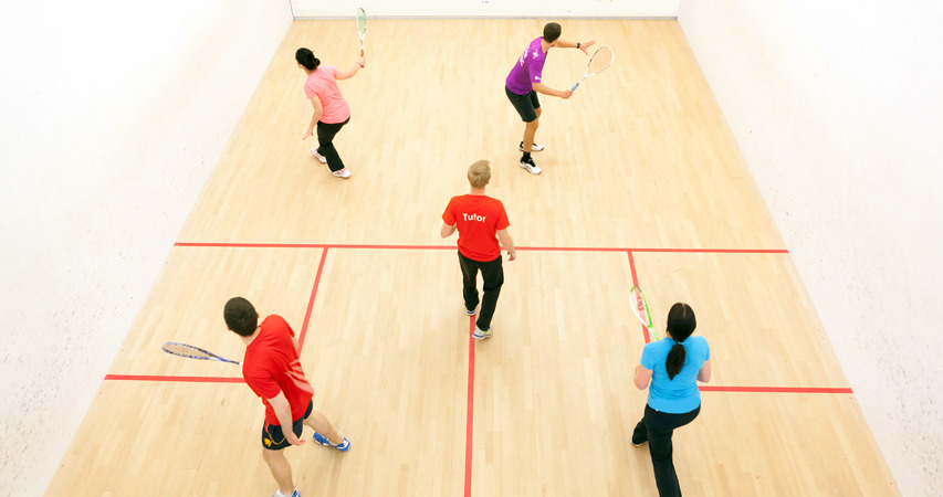 Tutor delivering a squash course