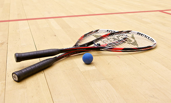 Two squash rackets on a court