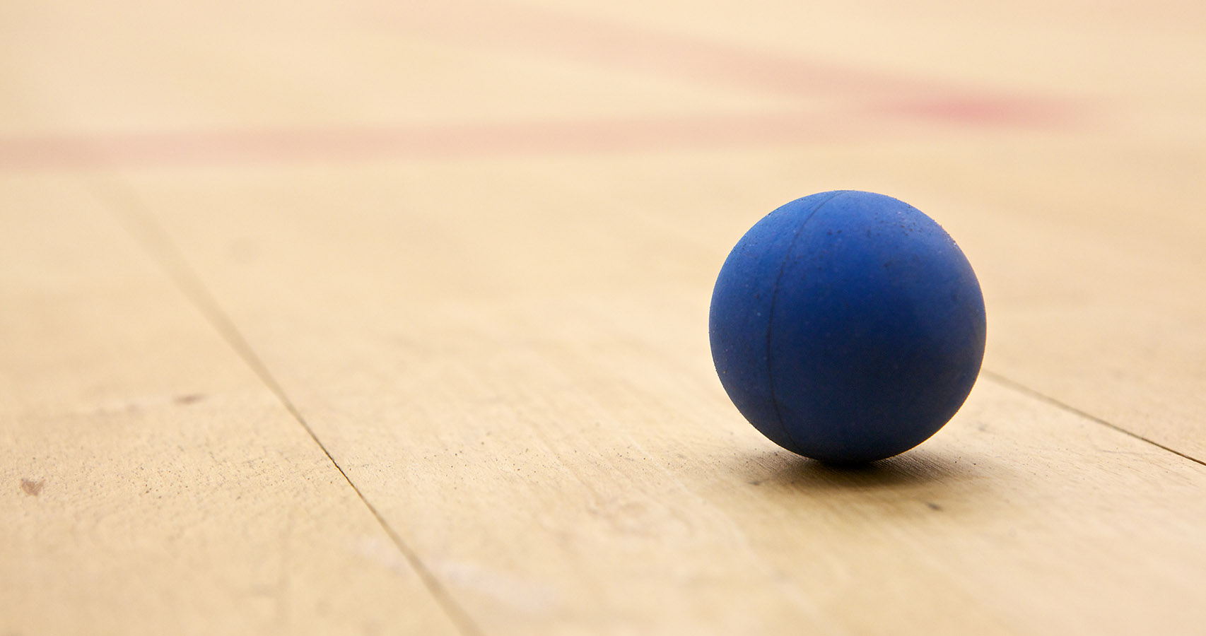 Squash ball on a court