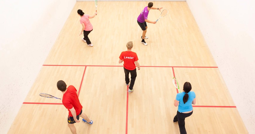 Players on a court playing Squash 101