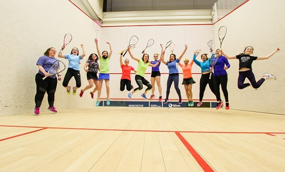 Women and girls playing Squash Girls Can