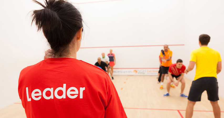Squash 101 leader coaching a 101 session