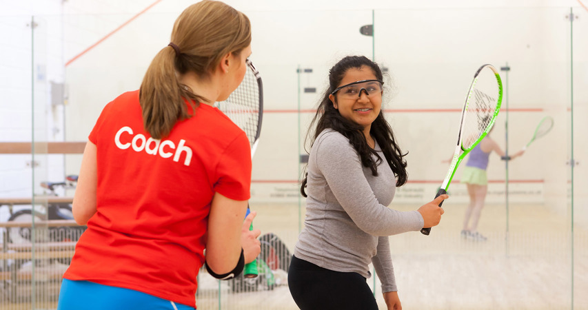 Female coach coaching a young teen