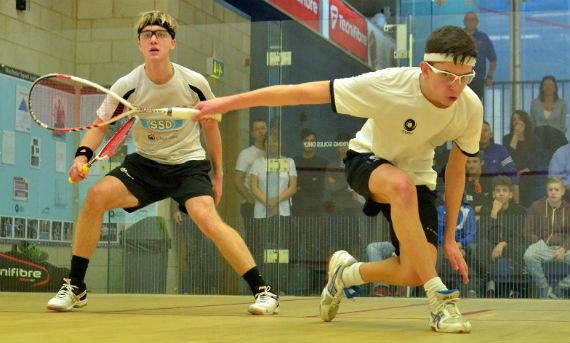 Teenagers playing squash