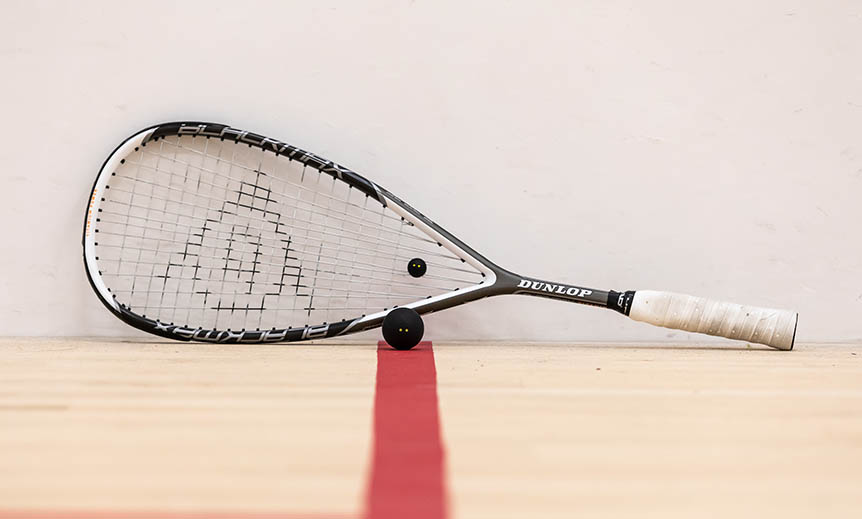 Squash racket on a court