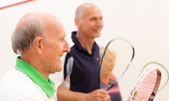 A man with a hearing aid on court