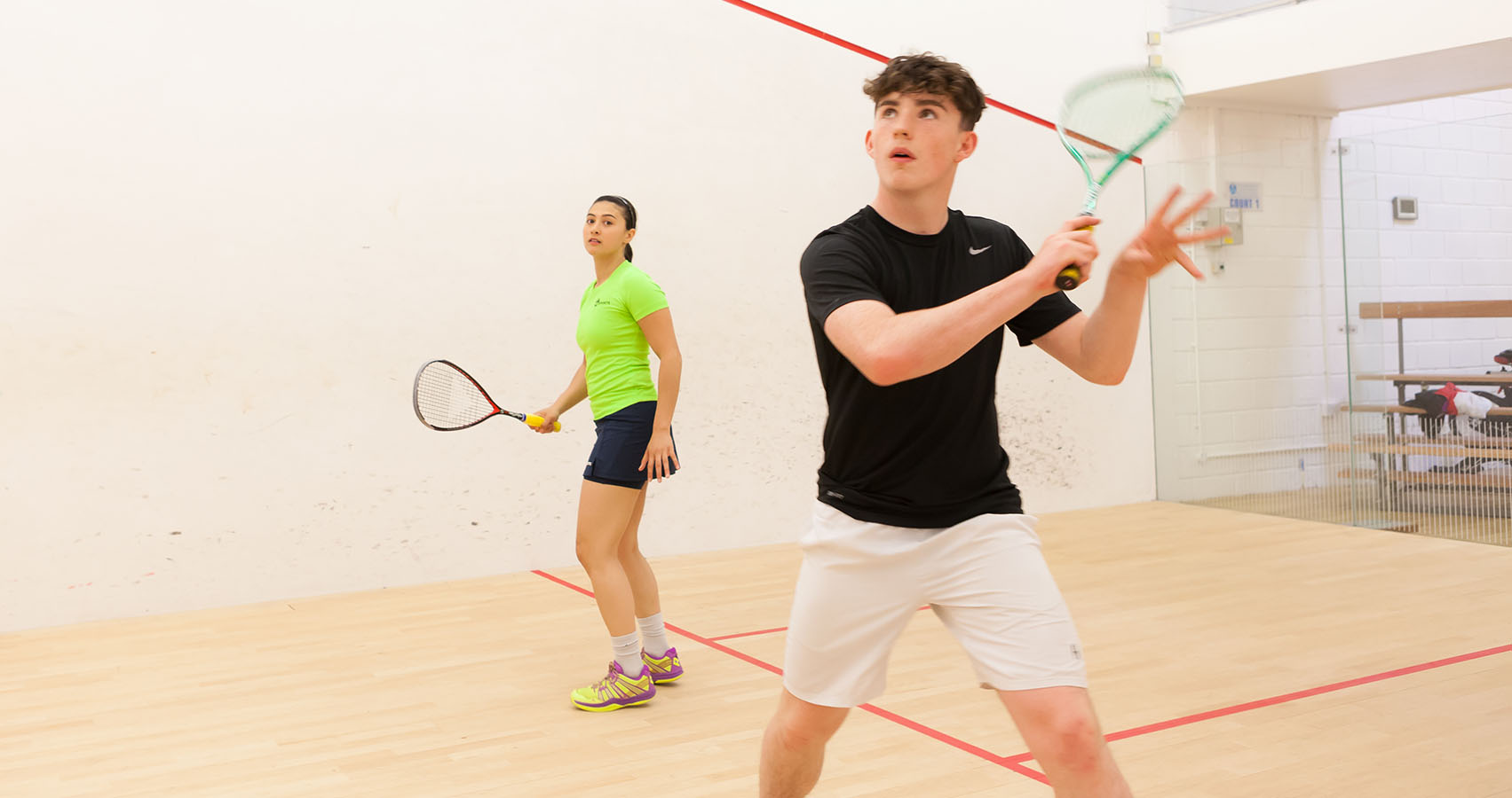 Female and male squash players