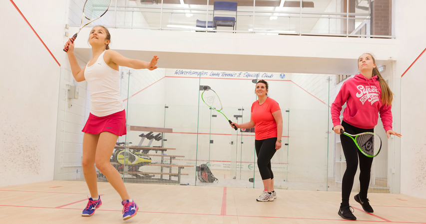 Girls playing squash