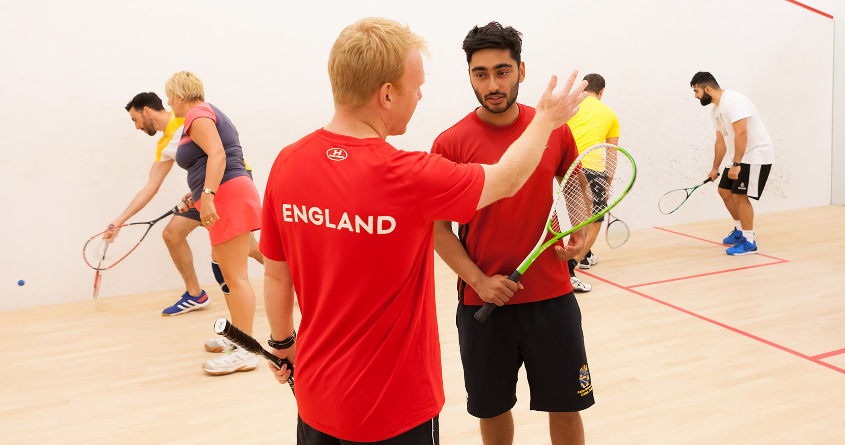 England squash coach with players