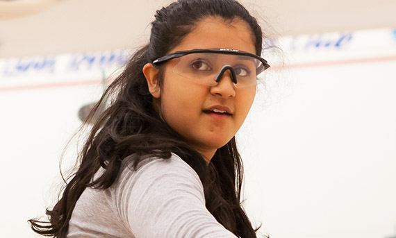 Teenager wearing protective squash eyewear