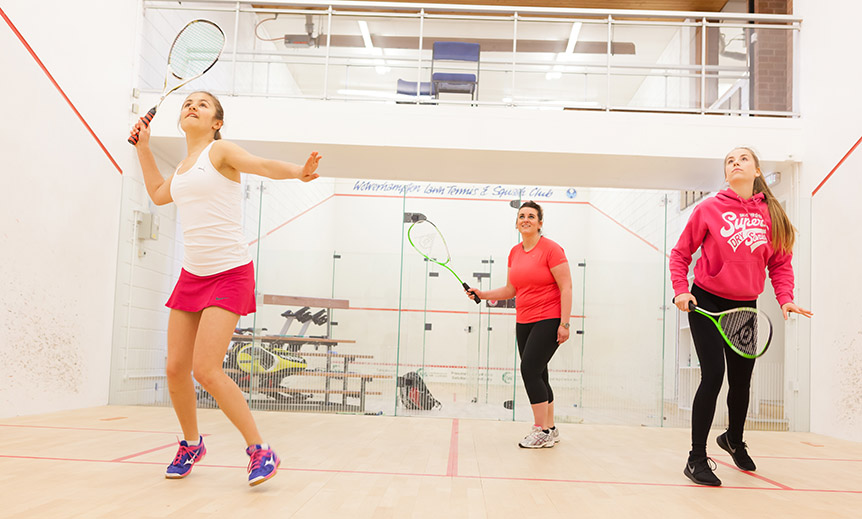 Women and girls playing squash